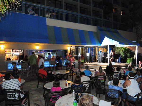 Enjoy entertainment onstage at the Splash Oceanfront Beach Bar & Grill (in season)